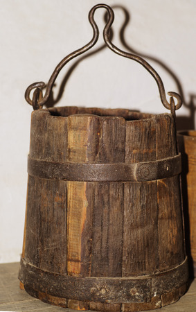 Wooden antique buckets for water with a metal handle.
