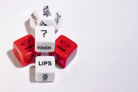 Playing cubes of red and white color for sexual games Stock Photo