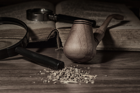 Smoking pipe with tobacco leaves on wooden background,Smoking pipe, Pipe for tobacco. Dry tobacco for smoking.
