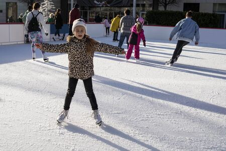 Slovakia, December 2018 ice skating.Active outdoor recreation, on the street. Small children skate on the rinks . 写真素材