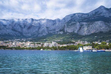 A beautiful view of Makarska beach through the pines. Dalmatia, Croatia.