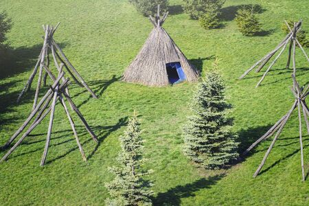 Wigwam type thatch huts .Straw wigwam on a glade on a sunny spring day.Outdoor recreation. Real nature.