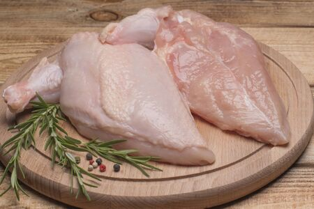 Fresh chicken meat. Fresh chicken fillet with a wing on a wooden cutting board.Raw chicken meat on wooden board. Healthy eating.Chiken supreme.