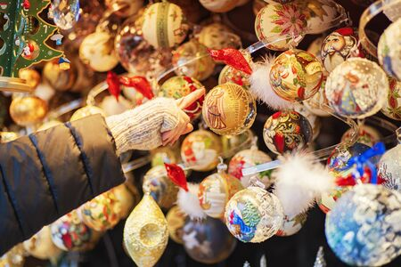 Christmas decorations balls and other miscellaneous toys at the Christmas market in Vienna. Christmas market in Vienna. 版權商用圖片