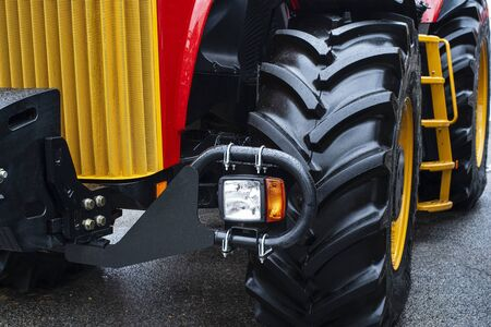 Hitch for tractors and combines.An image of a fragment of an agricultural machine.The image of a fragment of the tractor. Headlight with turn signal.