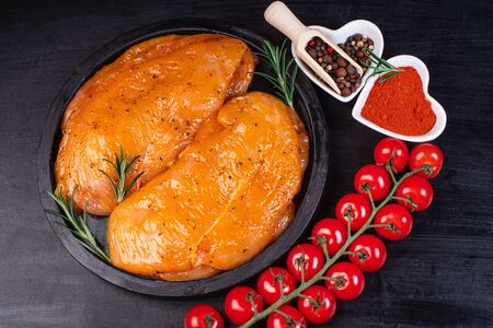 Sottilissime. Delicious dietary meat. Cooking,food of meat and fillets.Close-up view of raw, fresh, choped and sliced chicken meat.Uncooked marinated chicken fillets with marinade ingredients.
