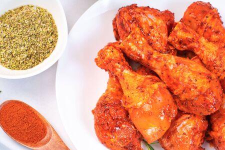 Raw spiced Chicken drumsticks.legs before cooking.Uncooked marinated chicken. Reklamní fotografie