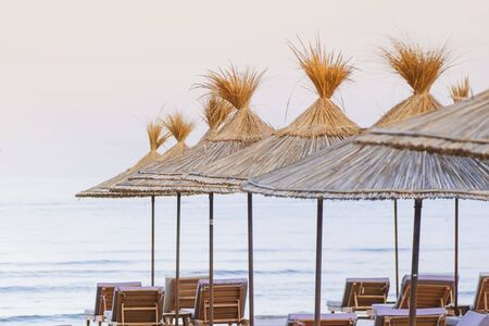 Beach thatched umbrellas on the beach promenade.Relax at sea.