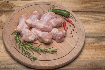 Raw chicken wings .Fresh raw chicken wings on a wooden cutting board.