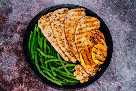 Grilled chicken and green beans. Selective focus.Grilled chicken fillet with green beans.