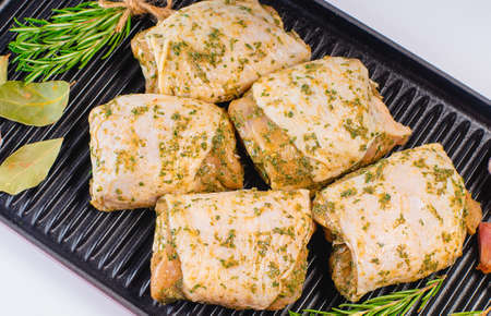 Fresh chicken meat.Raw marinated chicken thighs for grill and bbq.Cooking Chicken.Uncooked marinated chicken legs and marinade ingredients. Imagens