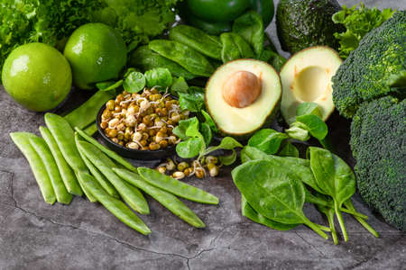 uper food, green, healthy food, vegetarian food and people concept, close up.Healthy eating, dieting, vegetarian food.A variety of green vegetables, green leavev of spinach.S