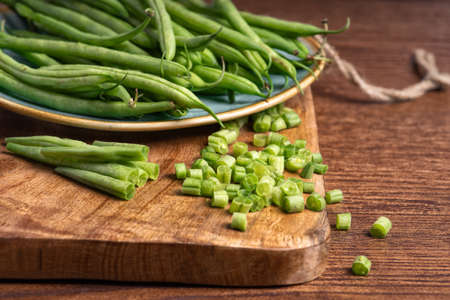 Raw food.healthy eating, close up, Green diet. Super food. Vegetarianism.Green young stalks of beans. Imagens