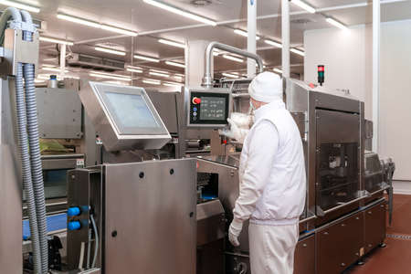 Factory for the production of food from meat.Conveyor Belt Food.Automated production line in modern food factory. Ravioli production. People working.Production line in the food factory. - stock photo.