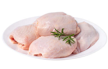 Raw chicken thighs on plate.Chicken Thigh White Plate Isolated Object White Background Raw Chicken Meat.