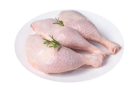 Whole Chicken Leg White Plate Isolated Object White Background Raw Chicken Meat.Raw meat products.