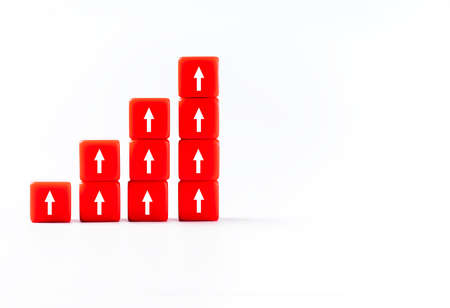 Business concept.Plastic red blocks with arrows of growth, the direction of the correct dynamic path. Plastic cubes on a white background for use in conceptual texts.