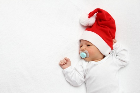 A beautiful baby with Santa Claus hat Stock Photo