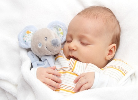 baby toddler asleep in bed with soft toy