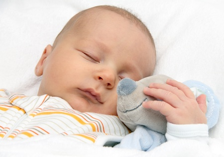 baby toddler asleep in bed with soft toy Stock Photo - 17276914