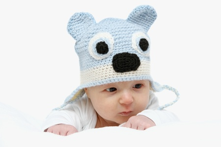 Baby with a knitted blue hat on stomach Stock Photo