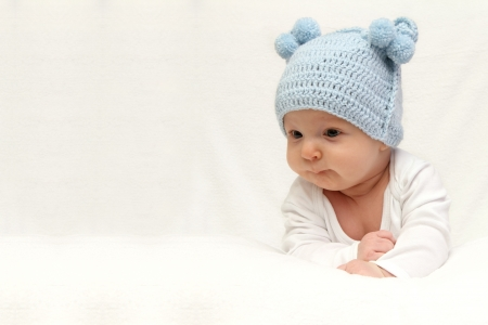 Beautiful baby in blue knitted hat  Stock Photo - 17413576