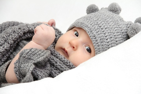 Beautiful baby in gray knitted hat Stock Photo - 17475090