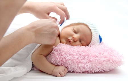 Mother covers sleeping baby with a blanket Stock Photo - 17602455