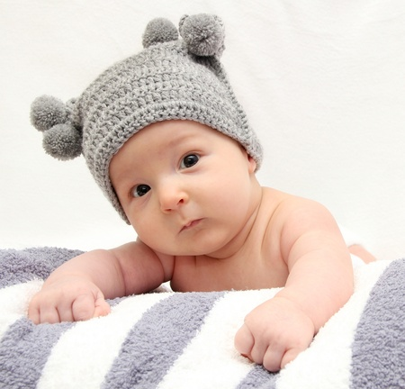 Beautiful baby in gray knitted hat