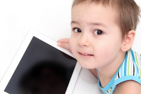 Child with digital tablet look at the camera Stock Photo - 17924931