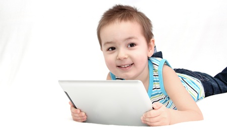 Child with digital touchpad look at the camera