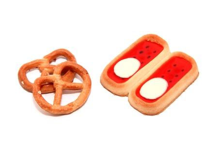 pretzel stick: Pretzels with biscuits on white