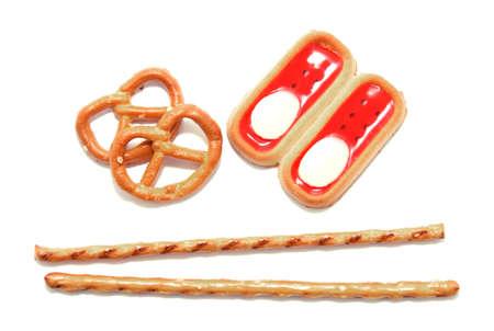 pretzel stick: Pretzel sticks with biscuits on white Stock Photo