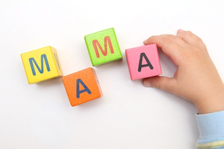 Child builds with cubes word mama photo