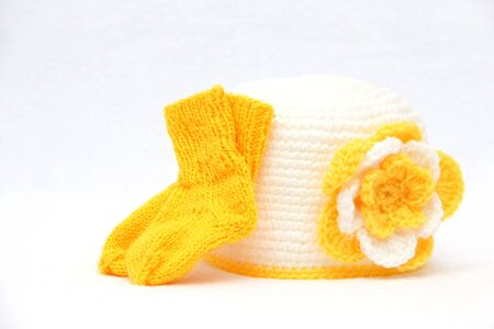 knitten: Knitted yellow cap with socks handwork