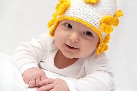 Happy baby looks at the camera