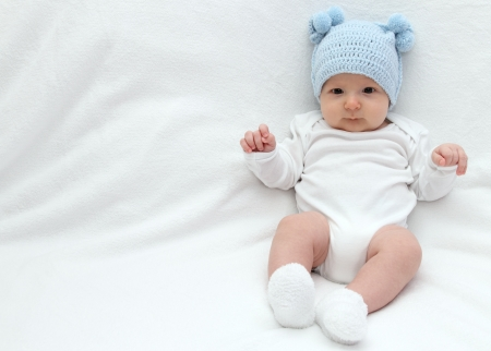 Beautiful baby in blue knitted hat  photo