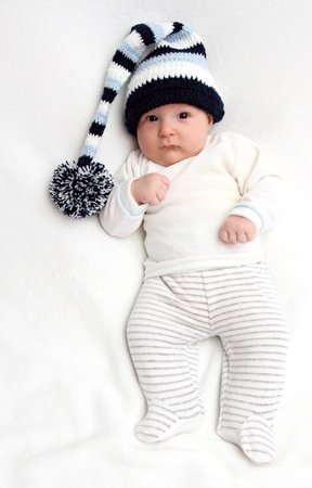 Beautiful baby in knitted hat photo