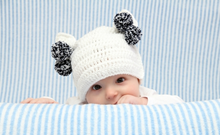 Baby with a knitted white hat Stock Photo