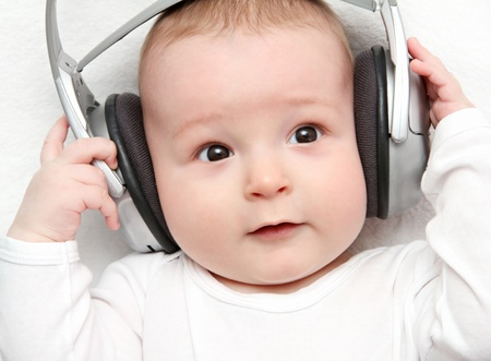 baby listening music on back photo