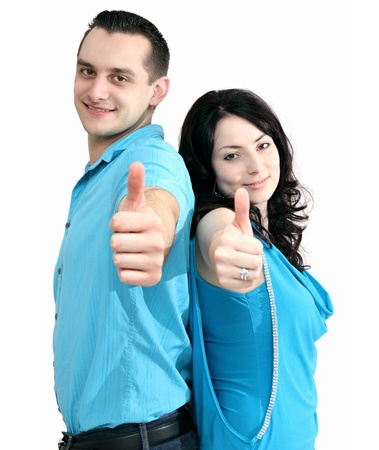 smiling couple shows thumbs-up photo