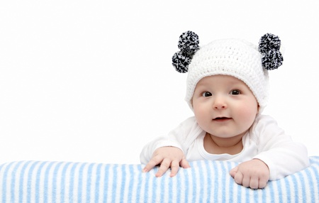 happy baby in white knitted hat  Stock Photo