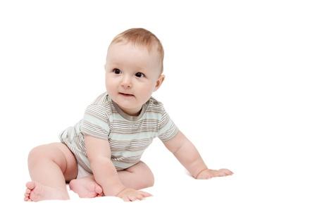 0 1 months: beautiful happy baby boy sitting on white background Stock Photo