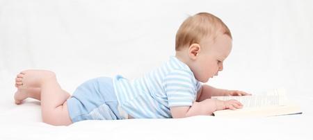 Baby boy reading a book
