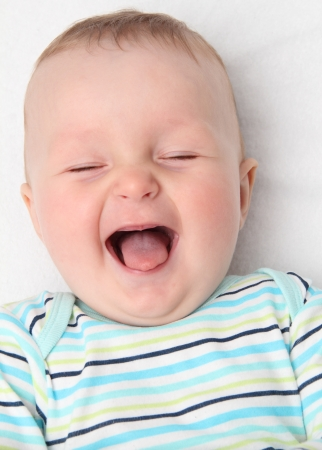 lying on back: happy baby laughing