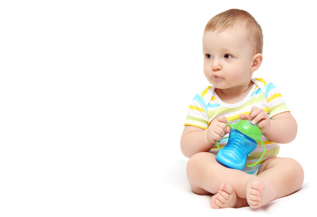 happy baby boy with milk bottle