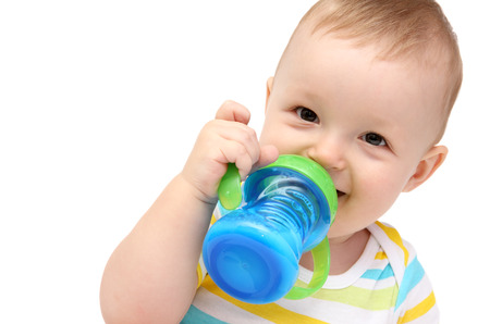 happy baby with milk bottle