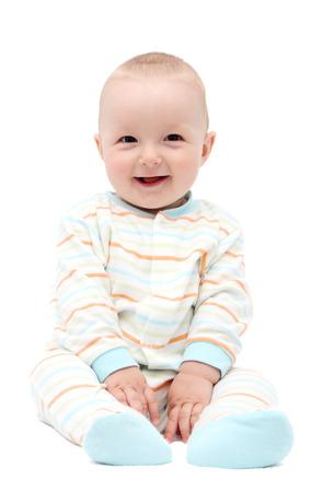 beautiful laughing baby boy sitting on white background