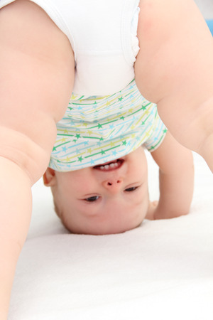 head down: baby standing on head
