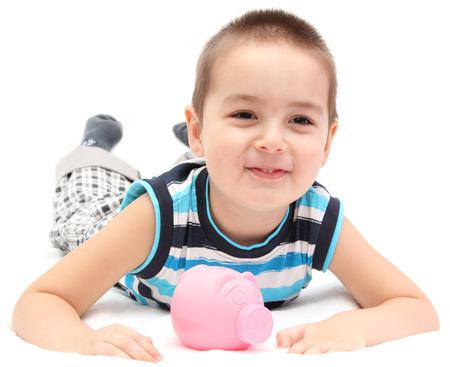 Glückliches Kind mit Sparschwein Standard-Bild - 27580307